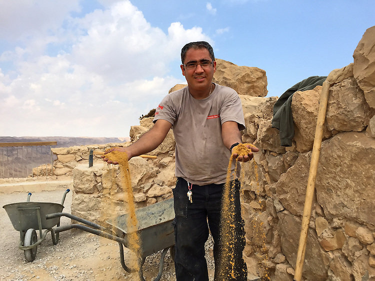 "15. ""Workman repairs walls of Masada"": Judean Desert.<br />