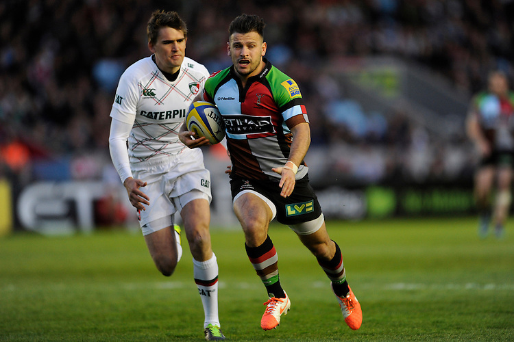 Danny Care of Harlequins takes a quick tap penalty and accelerates past Toby Flood of Leicester Tigers during the Aviva Premiership match between Harlequins and Leicester Tigers at the Twickenham Stoop on Friday 18th April 2014 (Photo by Rob Munro)