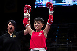 The judge rises the arm of Au Yin Yin Winnie (Red) of Hong Kong as she wins the gold medal in the female muay 51KG division weight final during the East Asian Muaythai Championships 2017 at the Queen Elizabeth Stadium on 13 August 2017, in Hong Kong, China. Au Yin Yin Winnie won the goal over opponent Umeo Mei of Japan. Photo by Yu Chun Christopher Wong / Power Sport Images