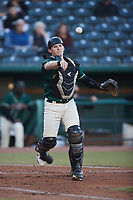 Greensboro Grasshoppers catcher Grant Koch (23) makes a throw to first base against the Hickory Crawdads at First National Bank Field on May 6, 2021 in Greensboro, North Carolina. (Brian Westerholt/Four Seam Images)