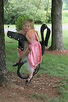children play rope swing