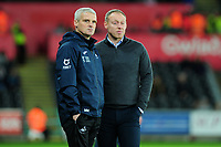 Mike Marsh, assistant first team coach for Swansea City watches on with Steve Cooper Head Coach of Swansea City during the Sky Bet Championship match between Swansea City and Barnsley at the Liberty Stadium in Swansea, Wales, UK. Sunday 29 December 2019