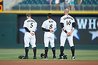 (L-R) Alex Presley (5), Jacob May (8), and Michael Saunders (16) stand for the National Anthem prior to the game against the Indianapolis Indians at BB&T BallPark on May 26, 2018 in Charlotte, North Carolina. The Indians defeated the Knights 6-2.  (Brian Westerholt/Four Seam Images)