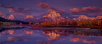 937000016 panoramic view dawn light casts alpenglow on the teton range reflected in the snake river at the oxbow bend of the snake river on an autumn morning with fall colored aspens in grand tetons national park wyoming