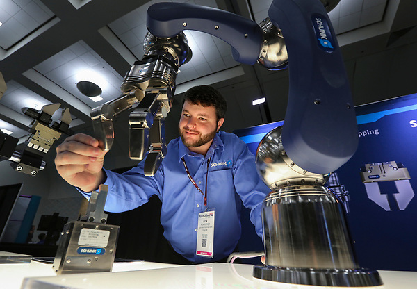 Dec. 16, 2015. San Diego,  CA. USA. Rick Hunsucker an Applications Engineer with Schunk, shows off his companies LWA 4P Powerball robotic arm at the RoboUniverse Conference and Expo held at the San Diego Convention Center.  Photos by Jamie Scott Lytle. Copyright.