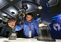 Dec. 16, 2015. San Diego,  CA. USA.|Rick Hunsucker an Applications Engineer with Schunk, shows off his companies LWA 4P Powerball robotic arm at the RoboUniverse Conference and Expo held at the San Diego Convention Center. |Photos by Jamie Scott Lytle. Copyright.