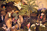 """Switzerland. Canton Tessin. Vira Gambarogno. The old town shows an exhibit of various Nativity scenes, illuminated at night for the Christmas holiday season. A Nativity Scene, may be used to describe any depiction of the Nativity of Jesus in art, but in the sense covered here, also called a crib or in North America and France a crèche (meaning """"crib"""" or """"manger"""" in French). It means a three-dimensional folk art depiction of the birth or birthplace of Jesus, either sculpted or using two-dimensional (cut-out) figures arranged in a three-dimensional setting. Christian nativity scenes, in two dimensions (drawings, paintings, icons, etc.) or three (sculpture or other three-dimensional crafts), usually show Jesus in a manger, Joseph and Mary in a barn (or cave) intended to accommodate farm animals. The scene includes the Magi or Three Wise Men (with or without a camel), shepherds and sheep, and the angels. Fir. © 2007 Didier Ruef"""