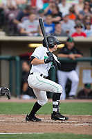 T.J. Friedl (6) of the Dayton Dragons follows through on his swing against the West Michigan Whitecaps at Fifth Third Field on May 29, 2017 in Dayton, Ohio.  The Dragons defeated the Whitecaps 4-2.  (Brian Westerholt/Four Seam Images)