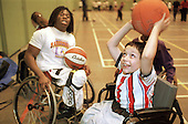 Wheelchair basketball star Ade Adepitan at a training session for Haringey school children, including pupils from the Vale School for children with disabilities, during National Inclusion Week.