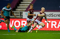 29th April 2021; DW Stadium, Wigan, Lancashire, England; BetFred Super League Rugby, Wigan Warriors versus Hull FC;  Adam Swift of Hull KR tries to hang onto Liam Farrell of Wigan Warriors but cannot stop him from scoring