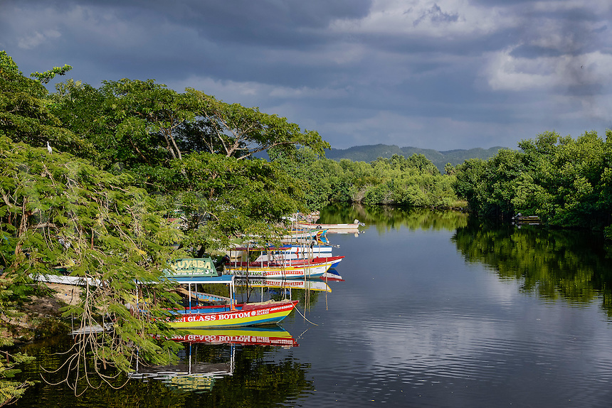 Excursion boats docked on theSouth Negril River, Jamaica