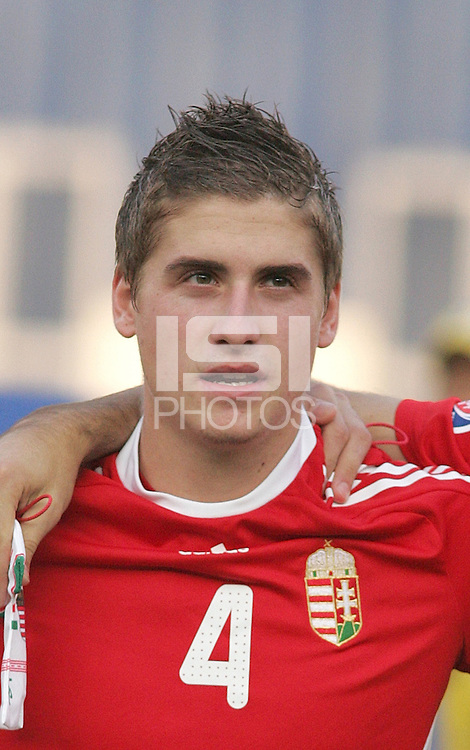 Hungary's Mate Kiss (4) stands on the field before the game against Ghana at the FIFA Under 20 World Cup Semi-final match at the Cairo International Stadium in Cairo, Egypt, on October 13, 2009. Costa Rica won the match 1-2 in overtime play. Ghana won the match 3-2.