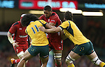 Wales number 8 Taulupe Faletau runs into trouble as Australia pair Joe Tomane and Sam Carter close in.<br /> Dove Men Series 2014<br /> Wales v Australia<br /> Millennium Stadium<br /> 08.11.14<br /> ©Steve Pope-SPORTINGWALES
