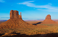 Monument Valley Utah desert mittens in panoramic of Western landscape at sunset Natioanal Park shadow of one mitten on another