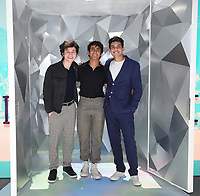 """SANTA MONICA, CA - JUNE 11: Anthony Turpel, Michael Cimino, and Anthony Kayvan pose for a photo at a special photo-activation in honor of Pride Month and the Season 2 premiere of the Hulu Original Series """"Love, Victor,"""" on June 11, 2021 in Santa Monica, California. (Photo by Frank Micelotta/Hulu/PictureGroup)"""