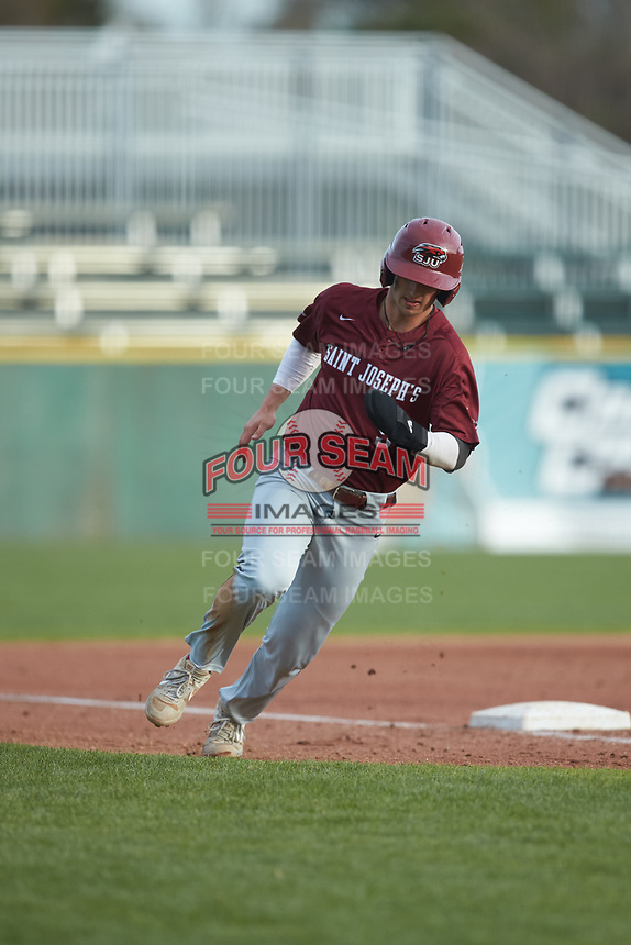Liam Bendo (5) of the Saint Joseph's Hawks rounds third base during the game against the Western Carolina Catamounts at TicketReturn.com Field at Pelicans Ballpark on February 23, 2020 in Myrtle Beach, South Carolina. The Hawks defeated the Catamounts 9-2. (Brian Westerholt/Four Seam Images)