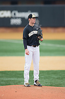 Wake Forest Demon Deacons relief pitcher Paul Kirkpatrick (42) looks to his catcher for the sign against the Towson Tigers at Wake Forest Baseball Park on March 1, 2015 in Winston-Salem, North Carolina.  The Demon Deacons defeated the Tigers 15-8.  (Brian Westerholt/Four Seam Images)