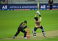 NZ's Devon Conway hits a four during the third international men's T20 cricket match between the New Zealand Black Capss and Australia at Sky Stadium in Wellington, New Zealand on Wednesday, 3 March 2021. Photo: Dave Lintott / lintottphoto.co.nz