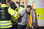 © Joel Goodman - 07973 332324 . 27/12/2016 . Wigan , UK . Police cuff and detain a man . Revellers in Wigan enjoy Boxing Day drinks and clubbing in Wigan Wallgate . In recent years a tradition has been established in which people go out wearing fancy-dress costumes on Boxing Day night . Photo credit : Joel Goodman