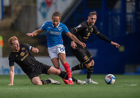 Portsmouth's Marcus Harness (centre) is tackled by Milton Keynes Dons' Dean Lewington (left) after holds off the challenge from Milton Keynes Dons' Richard Keogh (right) <br /> <br /> Photographer David Horton/CameraSport<br /> <br /> The EFL Sky Bet League One - Portsmouth v Milton Keynes Dons - Saturday 10th October 2020 - Fratton Park - Portsmouth<br /> <br /> World Copyright © 2020 CameraSport. All rights reserved. 43 Linden Ave. Countesthorpe. Leicester. England. LE8 5PG - Tel: +44 (0) 116 277 4147 - admin@camerasport.com - www.camerasport.com