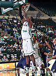 North Texas Mean Green forward George Odufuwa (4) goes in for a lay up in the game between the Jackson State Tigers and the University of North Texas Mean Green at the North Texas Coliseum,the Super Pit, in Denton, Texas. UNT defeated Jackson 68 to 49