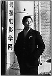 Li photographed by his classmate Zheng Lianyi at the entrance of the Changchun Film School during his second year in Changchun, Jilin province. 25 December 1961
