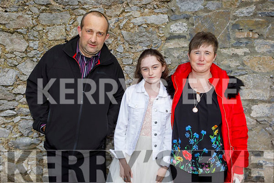 Rachel McCluskey former student of Presentation NS receiving her Confirmation in St John's Church on Sunday with her parents Richard and Susan McCluskey.
