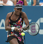 Venus Williams (USA) warms up before the rain delay during her match against Jie Zheng (CHN) at the US Open being played at USTA Billie Jean King National Tennis Center in Flushing, NY on August 28, 2013