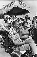 Seeing expo cheaply was the theme Jack Benny; the world's most popular tightwad; was promoting as he pedalled Ontario Liberal leader Robert Nixon and his wife around La Ronde. Later he gave them a picnic lunch.<br /> <br /> PHOTO :  Jeff Goode - Toronto Star Archives - AQP