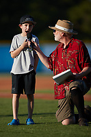 """A young fan gets to yell """"Play Ball"""" at the start of the game between the Danville Otterbots and the Burlington Sock Puppets at Burlington Athletic Park on June 5, 2021 in Burlington, North Carolina. (Brian Westerholt/Four Seam Images)"""