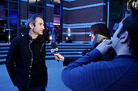 October 14 2004, Montreal (Quebec) CANADA<br /> Filmmaker Olivier Assayas beeing interviewed at the New Cinema Festival <br /> opening reception, October 14 2004