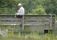 Jared Timmons (11), of Beaver Creek, fishes from a dock during a fishing derby Saturday June 11, 2005, in Bellbrook, Ohio.
