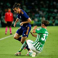 28th August 2021; Benito Villamarín Stadium, Seville, Spain, Spanish La Liga Football, Real Betis versus Real Madrid; Real Madrid player Gareth Bale slide tackled by Betis' Juan Miranda