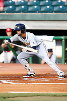 Nathan Lukes (2) of the Montgomery Biscuits lays down a bunt in a game against the Chattanooga Lookouts on May 25, 2018 at AT&T Field in Chattanooga, Tennessee. (Andy Mitchell/Four Seam Images)