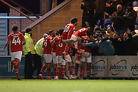 Diallang Jaiyesimi of Swindon Town scores the first goal for his team and celebrates with his team mates during Colchester United vs Swindon Town, Sky Bet EFL League 2 Football at the JobServe Community Stadium on 28th January 2020