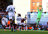 Pictured: Goalkeeper Adrian of West Ham (R) catches the ball, Wilfried Bony of Swansea (10) looks on. 01 February 2014<br /> Re: Barclay's Premier League, West Ham United v Swansea City FC at Boleyn Ground, London.