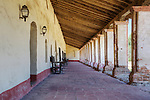 Courtyard, outdoor walkway with tile floors, adobe walls, beamed cieling, and no people at Mission La Purisima State Historic Park, Lompoc, California.  Mission La Purisima, founded in 1787 by Franciscan Padre Presidente Fermin Francisco Lasuen. La Purisima was the eleventh mission of the twenty-one Spanish Missions established in what later became the state of California.