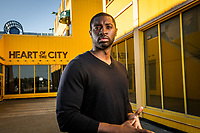 UAA Sociology alum Lonnie Ridgeway, Coalition Director for Public Health and Prevention for VOA Alaska, photographed outside Heart of the City Church in downtown Anchorage.