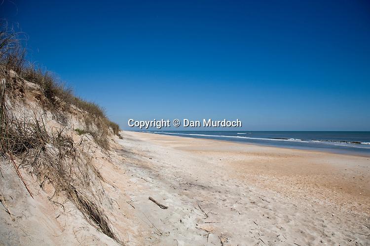 Sand dune at beachside under beautiful blue skies, Ponte Vedra, Florida