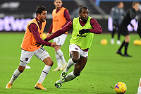 Pablo Fornals of West Ham United and Michail Antonio of West Ham United warm up during West Ham United vs Aston Villa, Premier League Football at The London Stadium on 30th November 2020