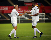 (L-R) Alan Curtis of Swansea greets John Williams during the Swansea Legends v Manchester United Legends at The Liberty Stadium, Swansea, Wales, UK. Wednesday 09 August 2017