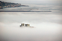 The heavy fog that enveloped most of Pacific Beach throughtout Sunday, June 22 2008 retreats enough to allow the top of the Capriby the Sea building on Missouri Street to emerge.  Ronan Gray Photo