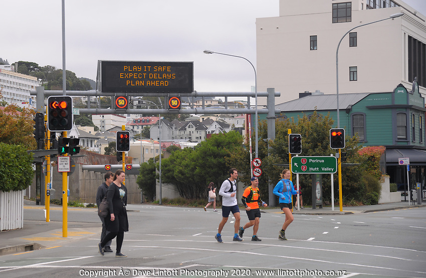 People cross the Willis St and Terrace Tunnel intersection during Alert Level 2 COVID-19 pandemic civil emergency conditions in Wellington, New Zealand on Saturday, 16 May 2020. Photo: Dave Lintott / lintottphoto.co.nz