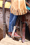 Cowboy boot, stirrup and chaps