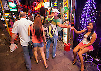 Sex workers on the streets of Wanchai District, Hong Kong on sunday evening 02nd November 2014. The area where British banker 29-year-old Rurik Jutting, alleged killer of 2 Asian women lived. <br /> <br /> PHOTO BY SINOPIX<br /> <br /> 02-Nov- 2014