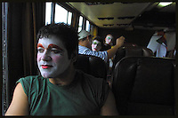 "Marcelo ""Lolo"" Iribarne is seen in the bus as Contrafarsa makes it's way to the inaugural parade of the Uruguayan Carnival. For more than a month, every night after the parade, the Contrafarsa members travel in the same bus from neighbourhood to neighbourhood,  to perform in the tablados ( a neighbourhood theatre built specially for the Carnival) in Montevideo, the capital city of Uruguay. ...."