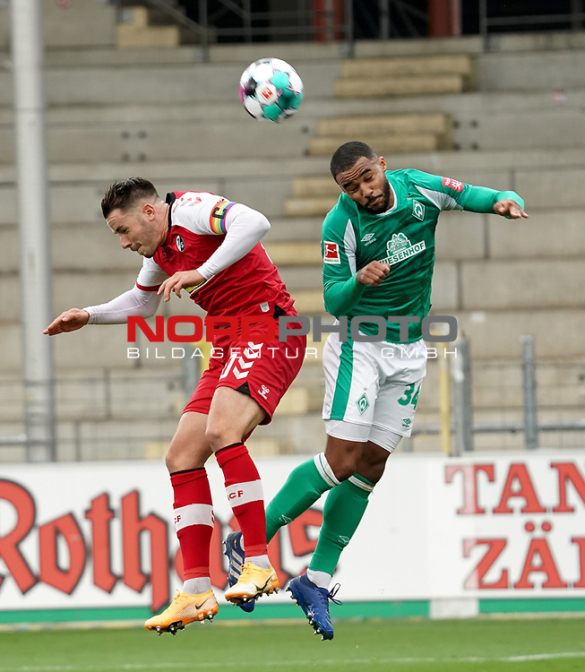 17.10.2020, Schwarzwald Stadion, Freiburg, GER, 1.FBL, SC Freiburg vs SV Werder Bremen<br /> <br /> im Bild / picture shows<br /> Christian Günter (Freiburg), Jean Manuel Mbom (Bremen)<br /> <br /> Foto © nordphoto / Bratic<br /> <br /> DFL REGULATIONS PROHIBIT ANY USE OF PHOTOGRAPHS AS IMAGE SEQUENCES AND/OR QUASI-VIDEO.