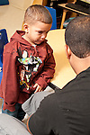 Education preschool first days of school 2-3 year olds two year old boy crying in anticipation of separation from father