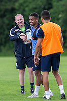 Paris Cowan-Hall laughs along with Assistant Manager Richard Dobson during the Wycombe Wanderers 2016/17 Pre Season Training Session at Wycombe Training Ground, High Wycombe, England on 1 July 2016. Photo by Andy Rowland / PRiME Media Images.