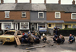 Rots rioting Catholic youth attacking the British army Belfast 1981 Northern Ireland Uk 1980s Hiding behind hijacked cars. Probably taken in Etna Drive, Ardoyne north Belfast.